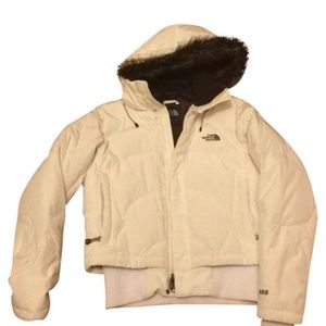 white puffy down north face jacket with faux fur